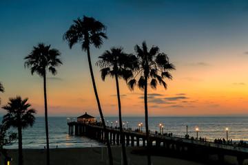 Fototapete - Palm trees at sunset on the California beach. Manhattan beach, los Angeles.