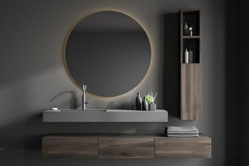 Gray bathroom interior with sink and mirror