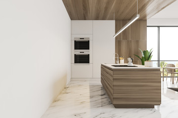 Side view of white and wooden kitchen with island