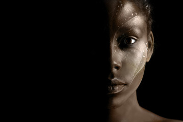 Art photo of Africal woman with tribal ethnic paintings on her face