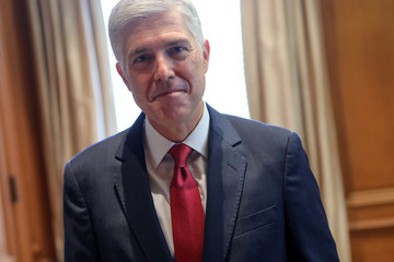 U.S. Supreme Court Justice Neil Gorsuch poses for a picture in his chambers at the Supreme Court building in Washington