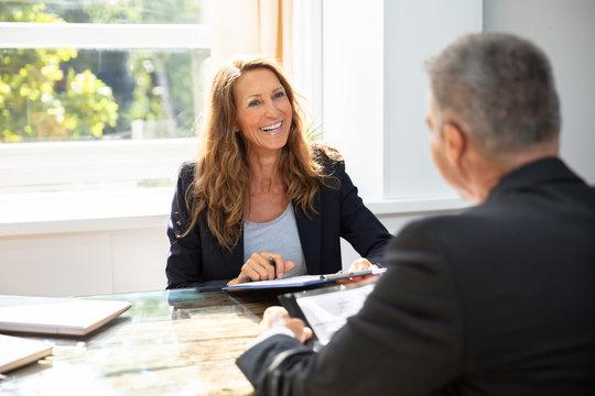 Businesswoman Taking An Interview Of Man