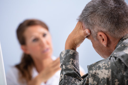 Doctor Counseling Soldier Suffering From Stress