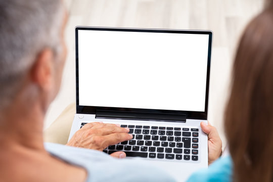 Close-up Of A Couple Using Laptop