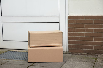 Delivery Of Parcel Boxes At Doorstep