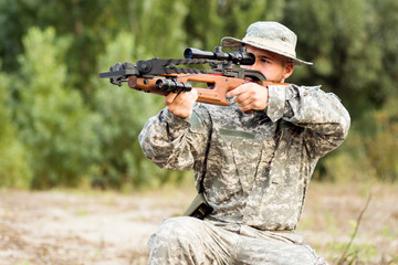 army soldier shooting with crossbow