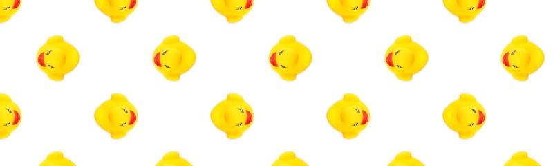 Duck background. Yellow plastic ducks. Yellow seamless pattern