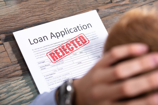 Person Looking At Rejected Loan Application