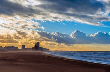 Cityscape of Ostend (Oostende) beach by the North Sea at sunset, Belgium.