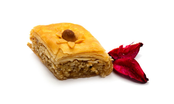 Baklava or baklawa, oriental Algerian traditional cookies withe rose petals