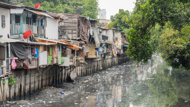 Bangkok, Thailand: slums along a smelly canal (Khlong Toei) full of mud and plastic garbage in Khlong Toei District.