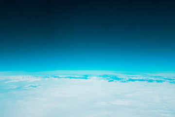 Low earth orbit - turquoise green space and white clouds