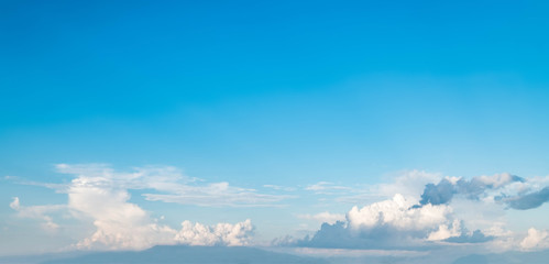 Blue sky and white clouds in bright day landscape background use for banner or cover background design.