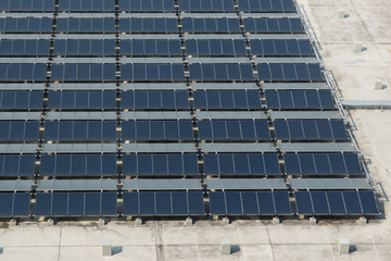 Solar panels at the rooftop of modern building