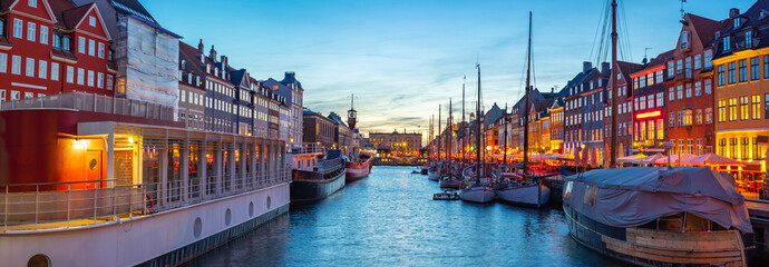 Panorama view of Copenhagen city skyline at night with view of Nyhavn in Copenhagen, Denmark