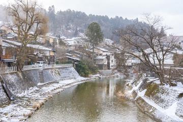Wall Mural - Takayama old town with snow falling in Gifu, Japan