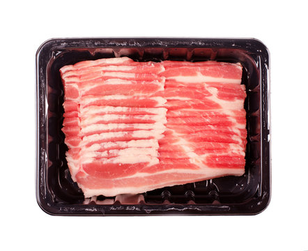 Raw pieces of raw bacon in package