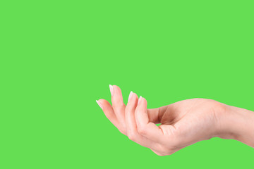 Closeup side view of beautiful white female cupped hand isolated on green background. Horizontal color photography.