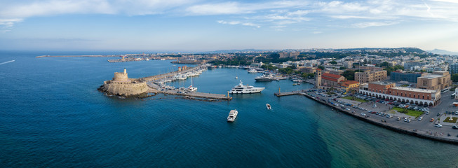 Aeria view of Rhodes city, Dodecanese, Greece. Panorama with Mandraki port, lagoon and clear blue water. Famous tourist destination in Europe