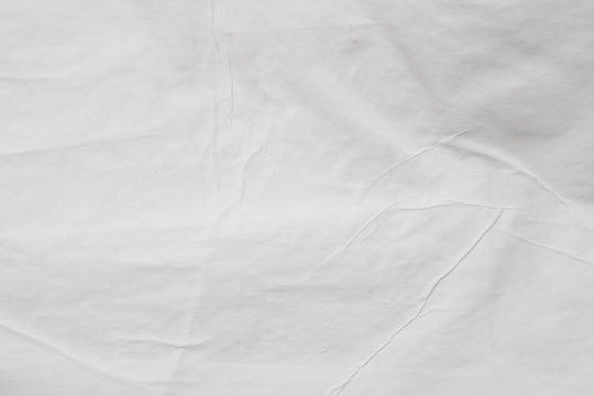 Gray colored wet paper. Wrinkled texture layers. Abstract art background. Copy space.