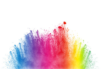 Abstract multi color powder explosion on white background.  Freeze motion of  dust  particles...