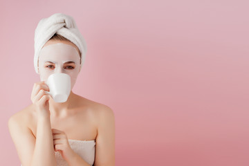 Portrait of beautiful girl in bathrobe with a cup of tea, relaxation concept blonde woman wearing bathrobe and towel on head after shower. Spa woman in bathrobe and turban