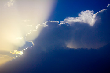 Sunlight rays from the clouds on a blue sky