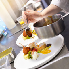 Chef preparing food in the kitchen, chef cooking, Chef decorating dish