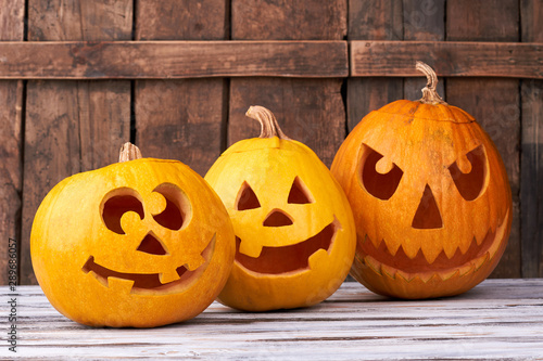 Three carved pumpkins for Halloween. Funny and angry pumpkins for Halloween. Seasonal Halloween decorations.
