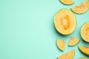 Fototapete - Flat lay composition with tasty melon on turquoise background, space for text