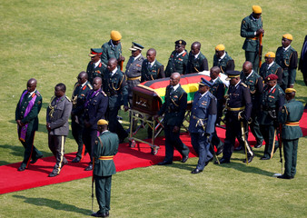 Coffin of Zimbabwe's founder and longtime ruler Robert Mugabe leaves the national sports stadium after his state funeral in Harare