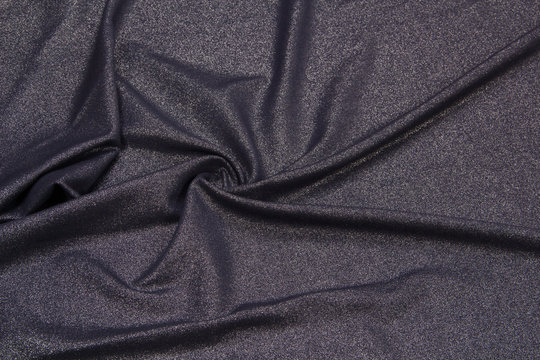 Lurex fabric is black. Shiny fabric texture
