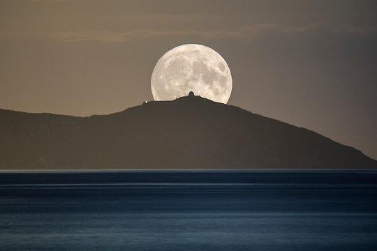 Harvest Moon composite image, rising over Rame Head peninsula, Cornwall, UK