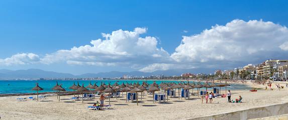 Panoramic image beach with parasols sunbeds of El Arenal resort town, Majorca, Spain