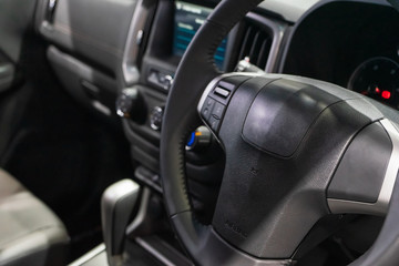 Interior view of modern car, Closeup of car steering wheel.