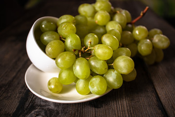 Fresh organic white grape on old wooden table