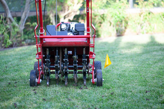 Red grass lawn aerator
