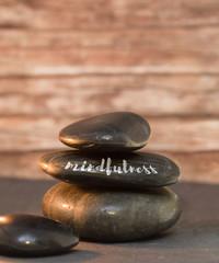 mindfulness word written on stone