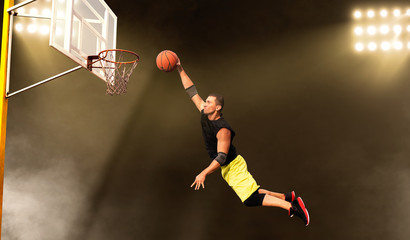 Basketball player makes a throw, shoot in action