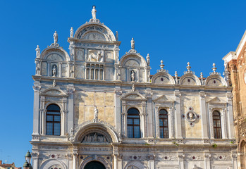 Fototapete - Scuola Grande di San Marco in Venice, Italy. It is a landmark of Venice. Ornate medieval facade of old building at Campo Santi Giovanni. Renaissance architecture of Venice in summer.