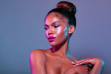 Beauty portrait fashion girl with color lighting filters. Beauty girl face close up. Closeup African American woman with copy space. neon light blue and pink color. - image .