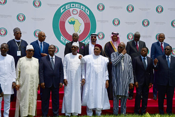 West African leaders and officials stand for a family photo at the ECOWAS extraordinary summit on terrorism in Ouagadougou