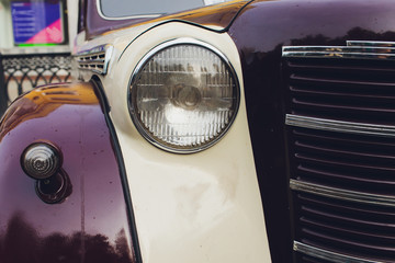 Retro styled image of a front of a classic car.