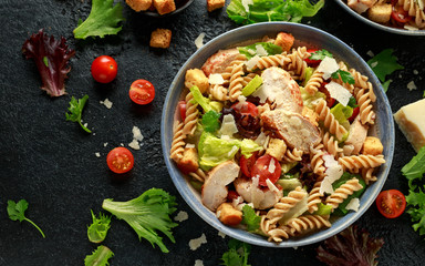 Caesar Salad Pasta with chicken, tomato, parmesan cheese and vegetables