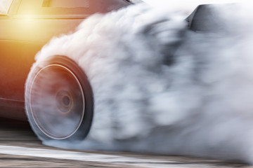 Car drifting, Blurred  image diffusion race drift car with lots of smoke from burning tires on...