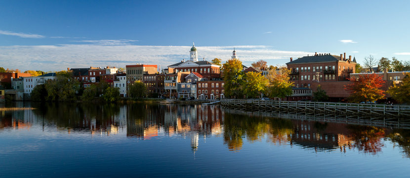 The river front buildings of Exeter, New Hampshire are seen reflected in the water