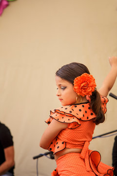 Close up of a Little child dancing spanish dance named Flamenco