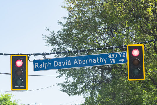 Road street direction sign for Ralph David Abernathy boulevard with traffic light in Atlanta, Georgia downtown midtown city in summer