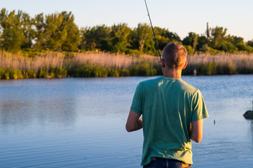 Young Male fishing