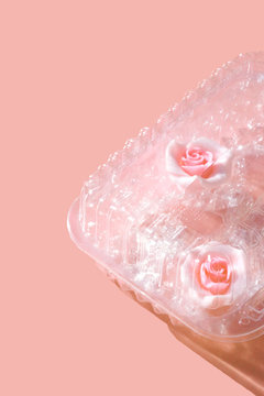 Pink Frosting Roses in Plastic Container